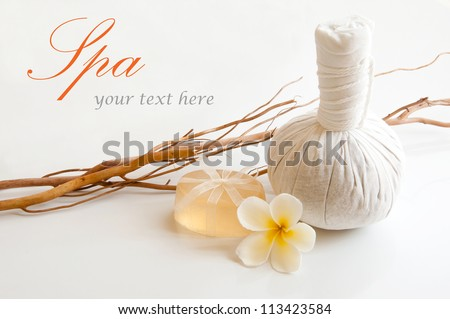 Spa still life with herbal massage ball and soap. - stock photo