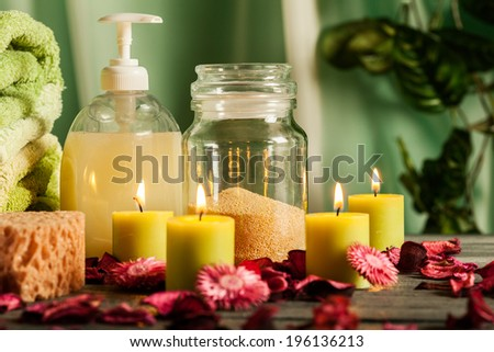 Spa still life with hot stones, essential oil and candles