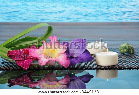 spa still life with lily on blue background - stock photo