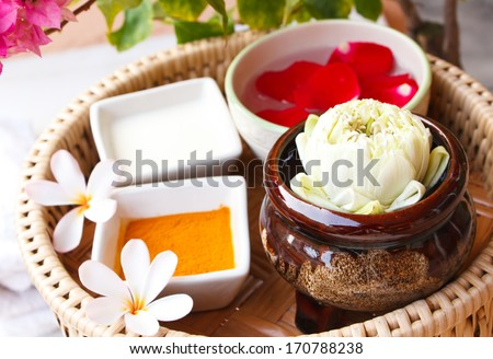 Spa still life with milk and herbal. - stock photo