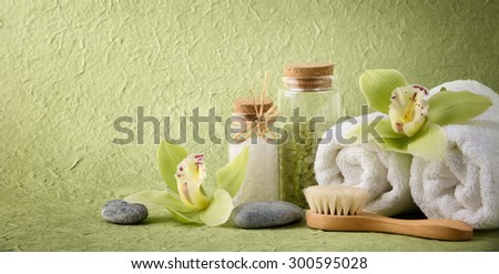 Spa still life with salt,towel,brush and blooming orchid - stock photo
