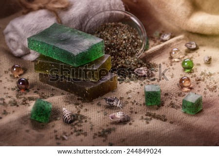 Spa still life with soap and water for a bath and sea salt. - stock photo