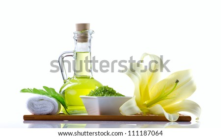 spa still-life with spa oil, sea salt and flower isolated on white - stock photo