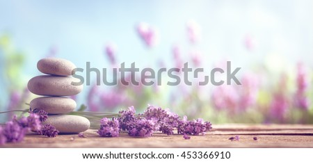 Spa still life with stack of stones and lavenders - stock photo
