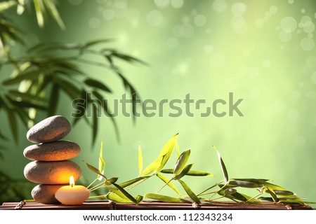 Spa still life with stacked of stone and bamboo leaf - stock photo
