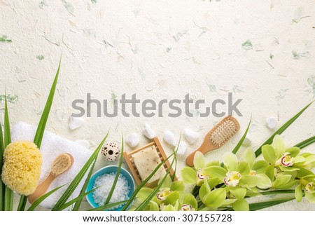 Spa still life with towel,brush,salt and orchid - stock photo
