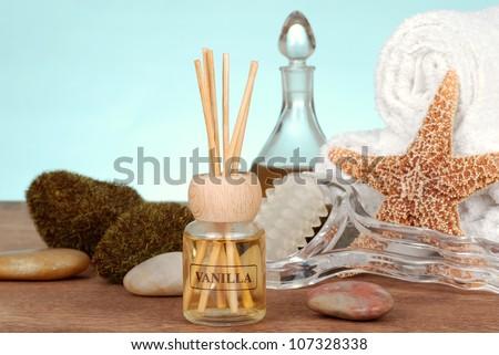 Spa still life with vanilla reed diffuser - stock photo