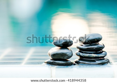 Spa still life with water lily and zen stone in a serenity pool.soft focus light. - stock photo