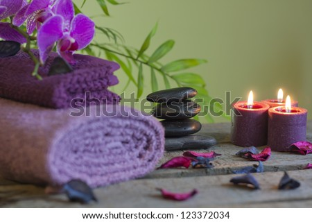 Spa still life with zen stones aromatic candles and orchids abstract background - stock photo