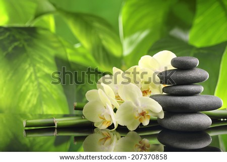 Spa still life with zen stones,bamboo and orchid flower - stock photo