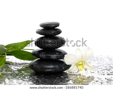 Spa still with Bamboo and stones with white orchid - stock photo
