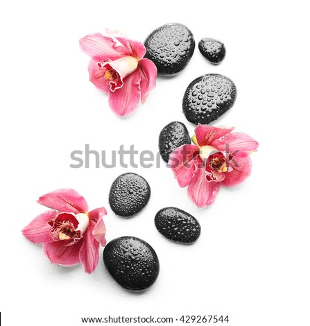 Spa stones and beautiful pink orchids on white background - stock photo