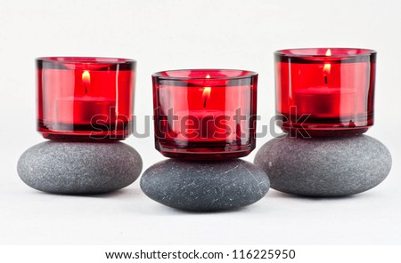 Spa stones and candles on white - stock photo