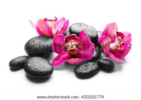 Spa stones and red orchid isolated on white