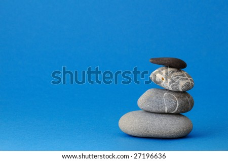 Spa stones on blue background