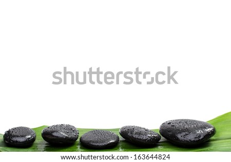 Spa stones   on green leaf, isolated background