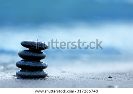 Spa stones on sea beach outdoors