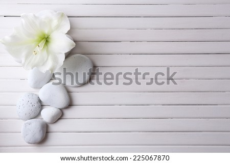 Spa stones on wooden table - stock photo