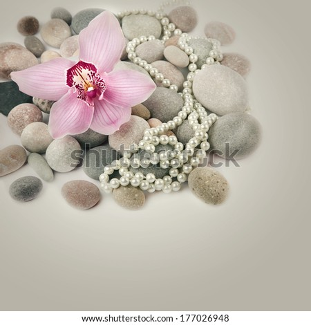 Spa stones, pink Orchid flower and pearls - stock photo