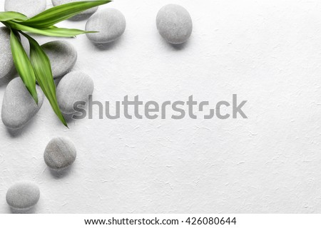 Spa stones with bamboo on paper - stock photo
