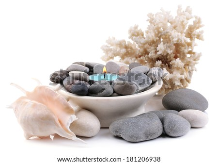 Spa stones with candle isolated on white - stock photo