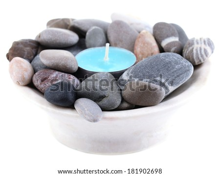 Spa stones with candle isolated on white
