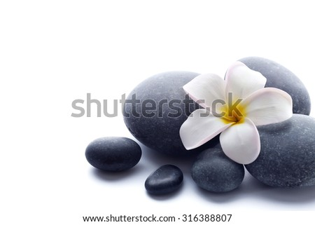 Spa stones with flower isolated on white