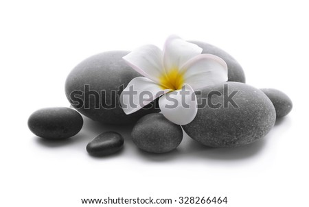Spa stones with flower isolated on white - stock photo