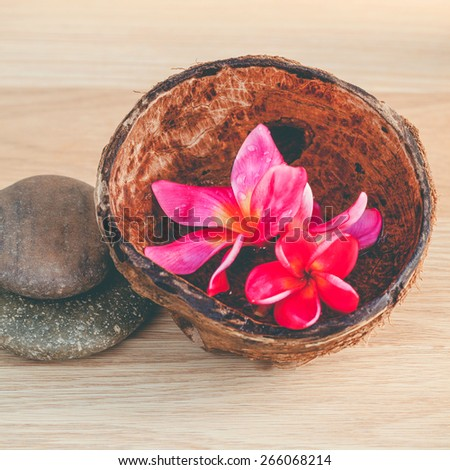 Spa stones with frangipani flower. - Concept for spa and meditation. - stock photo