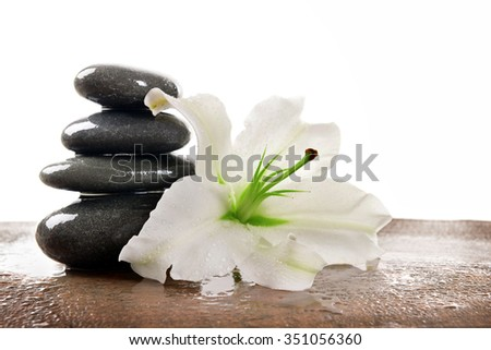 Spa stones with lily, isolated on white