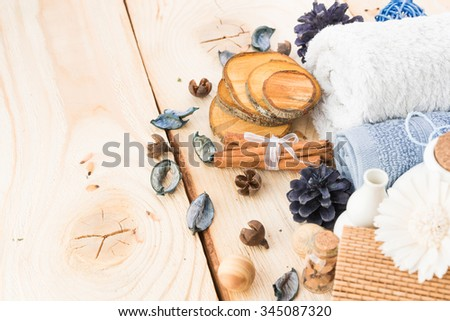 spa stuff, cinnamonand flower with towel on wood