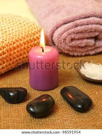 Spa therapy composition with candles and massage stones - stock photo