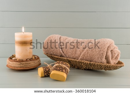 Spa Towel with Candle and Artisan Soap - stock photo