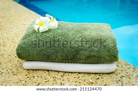 spa towels near the swimming pool. - stock photo