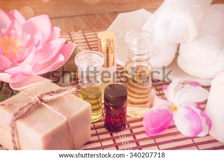 Spa treatment, rose aroma oil and soap bar - stock photo