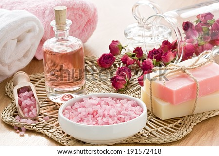 SPA treatment set with sea salt, rose aroma oil and soap bar  - stock photo