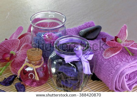 Spa treatment setting with purple theme