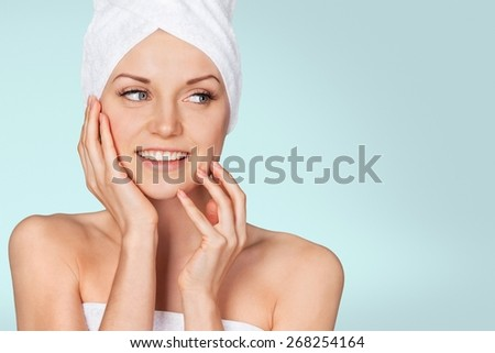 Spa Treatment. Smiling Woman Getting a Facial Treatment - stock photo