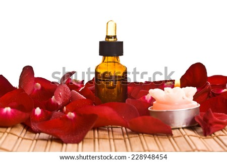 Spa Treatment with aromatic roses, petals, oil, and candle. - stock photo