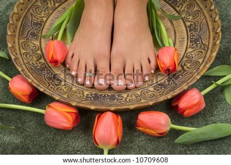 Spa treatment with beautiful elegant tulips - stock photo