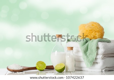 Spa treatment with lime and salts with towels and sponge