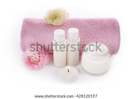 Spa treatment with towel and cream isolated on white