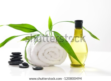 Spa treatment with towels and green bamboo - stock photo