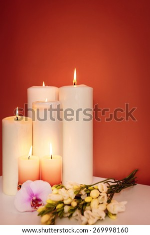 spa treatments. burning candles - stock photo