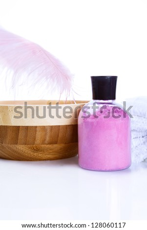 Spa Treatments on a white background and pink feather