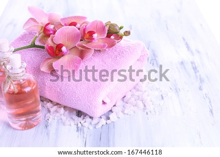 Spa treatments on color wooden background - stock photo