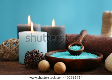 Spa treatments on wooden table against blue background - stock photo