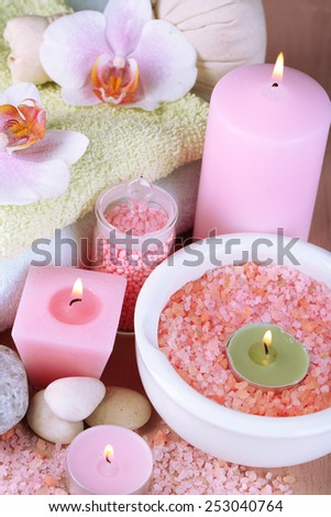 Spa treatments with orchid flower on wooden table on colorful background - stock photo