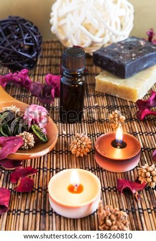 Spa with natural bath salt; candles; soap; towels and petals - stock photo