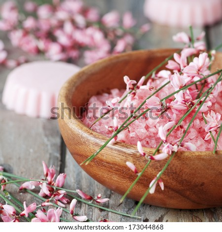 Spa with pink salt, flowers and soap, selective focus and square image